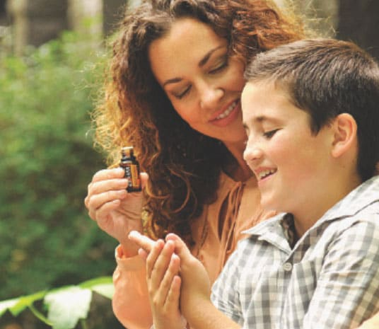 Mother and Son using dōTERRA products